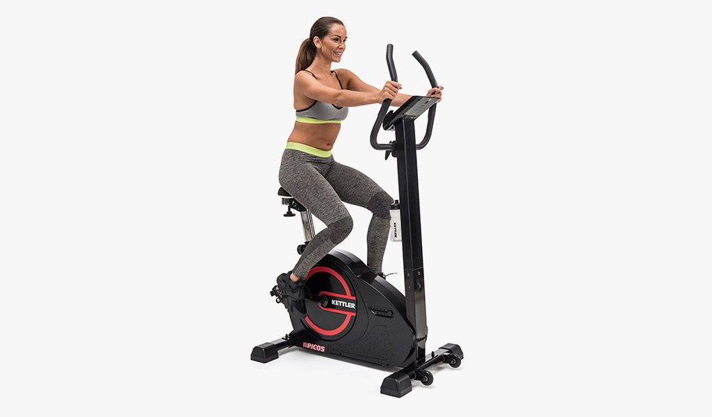 Woman exercising on the Picos Exercise Bike.