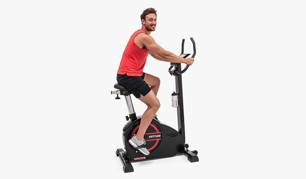 Man exercising on the Picos Exercise Bike.