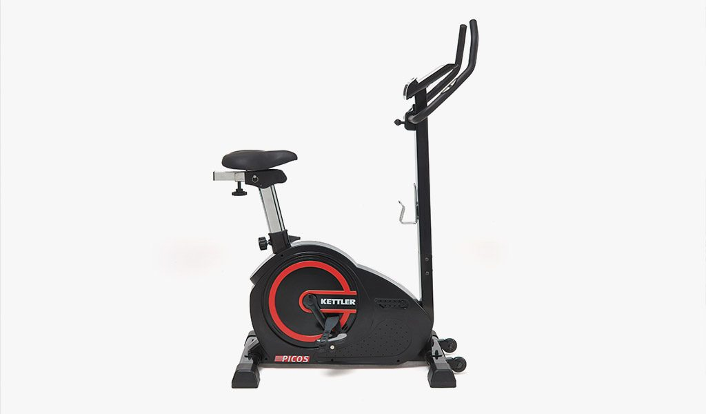 Sideview of the Picos Exercise Bike from KETTLER's Fitness range on a gray background.