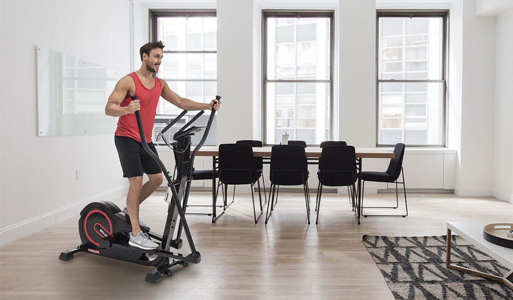 Man exercising in a modern flat on the Sella Crosstrainer.