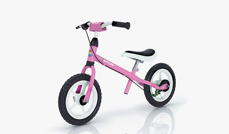 The Pink Speedy 12.5 inch Balance Bike from KETTLER's tpy range on a grey background.