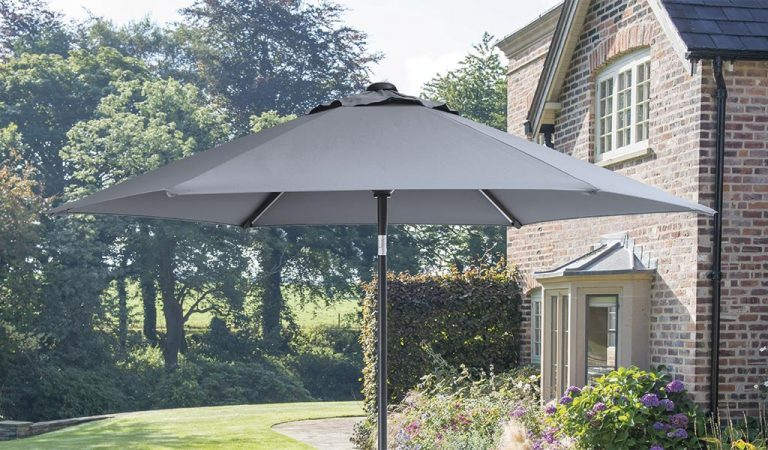 2.5m Wind Up Parasol with Slate coloured fabric in front of a house.
