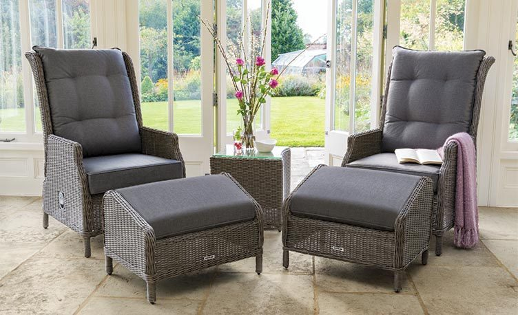 Two Classic Recliner with Footstool from KETTLER's Classic Garden Furniture range in a conservatory.
