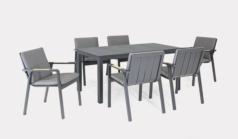 The Paros 6 Seat Dining Set On A Grey Background.