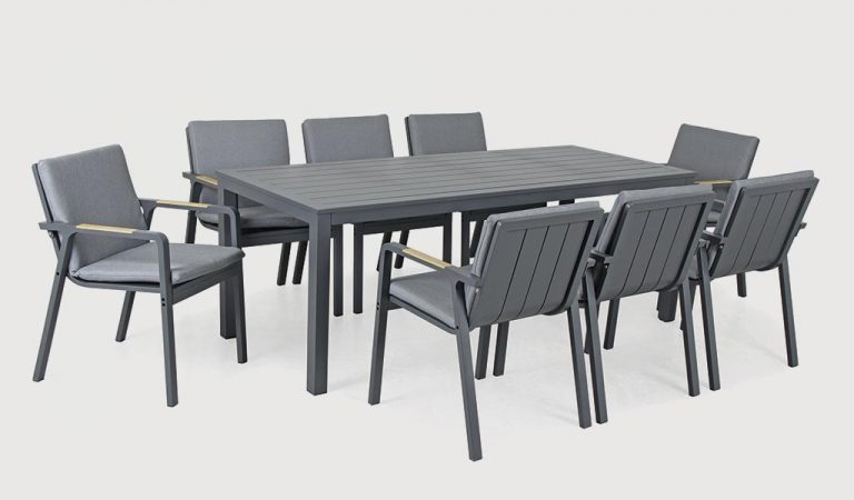 The Paros 8 Seat Dining Set on a grey background.