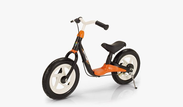 The Spirit Air Rocket Balance Bike on a grey background.