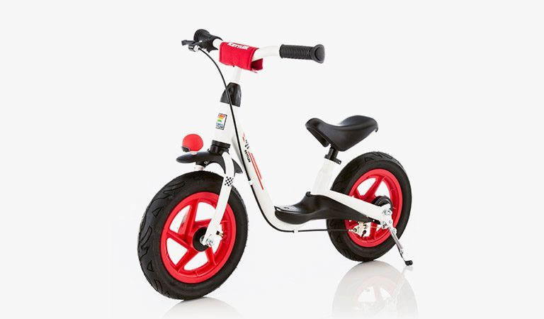 The Sprint Air Racing Balance Bike on a grey background.