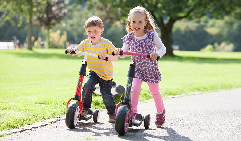 Young girl and boy playing on KETTLER's Scooter