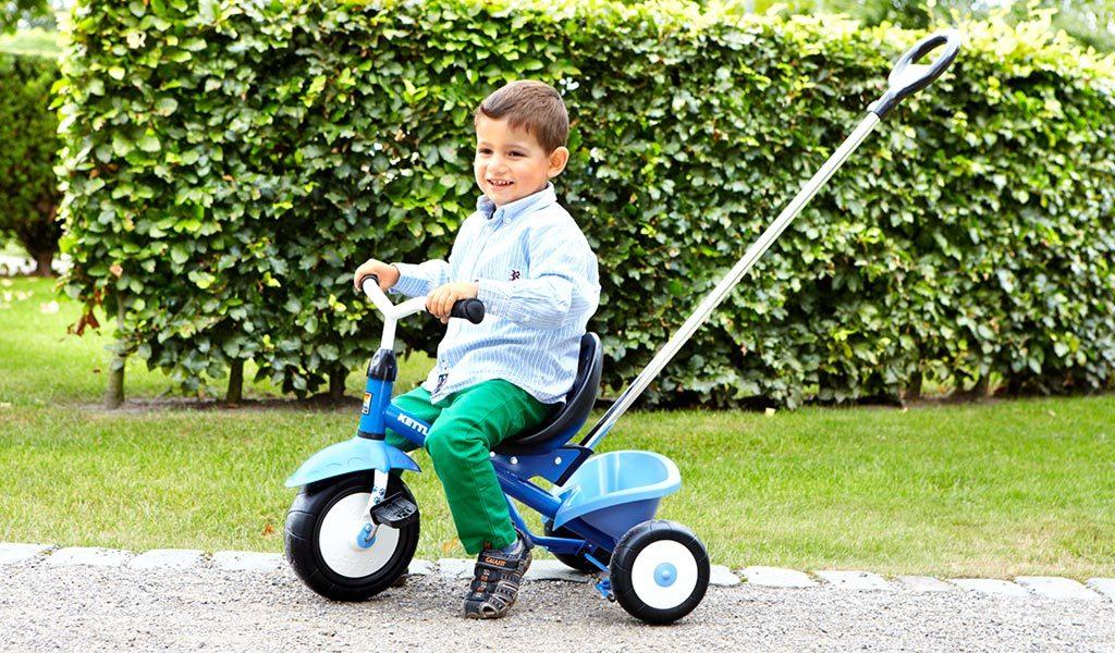 Young boy riding the Funtrike Waldi