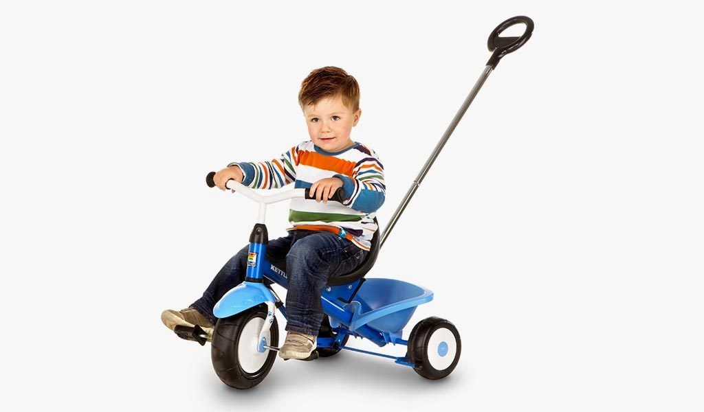 Studio image of a boy riding the Funtrike Waldi