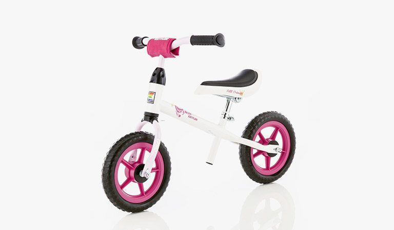 "Kettler's Speedy 10"" Princess balance bike on a grey background."