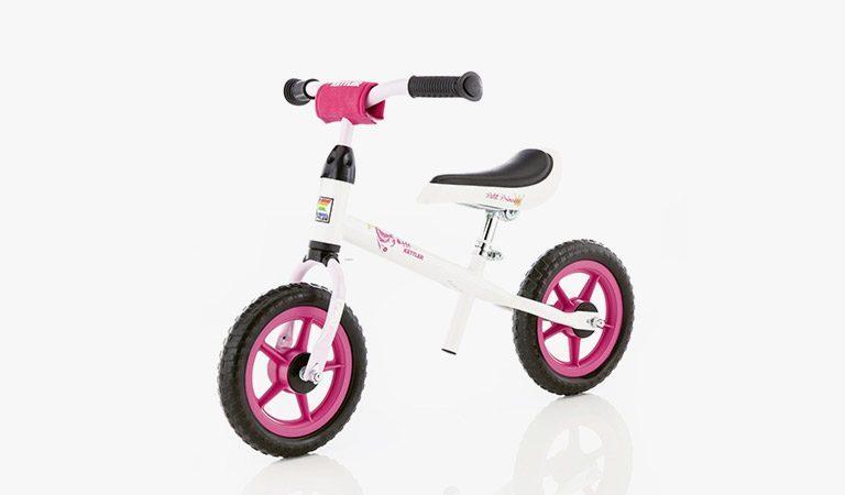 "Kettler's Speedy 10"" Princess balance bike on a grey background."