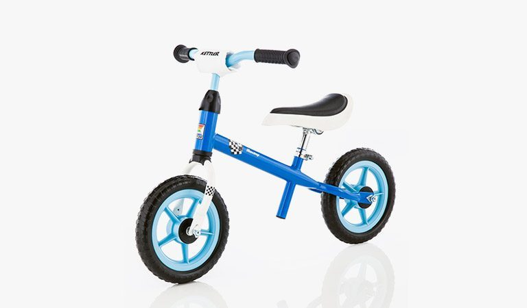 "Kettler's Speedy 10"" Racing Balance Bike on a grey background."