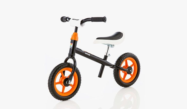 "Kettler's Speedy 10"" Rocket balance bike on a grey background."