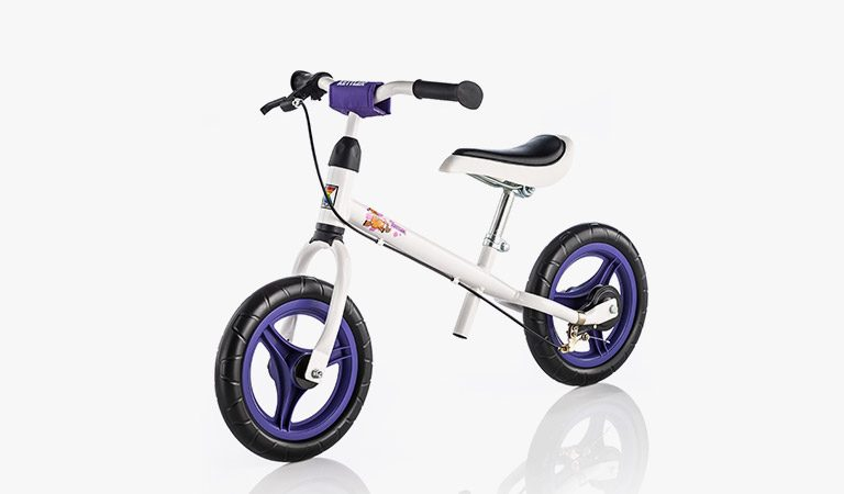 "Kettler's Speedy 12.5""Pablo Balance Bike on a grey background."