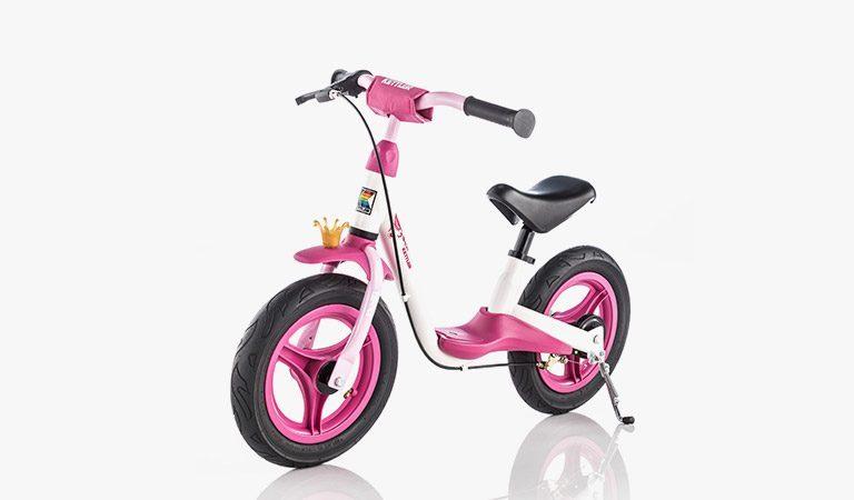 "Kettler's Spirit Air 12.5"" Princess balance bike on a grey background."