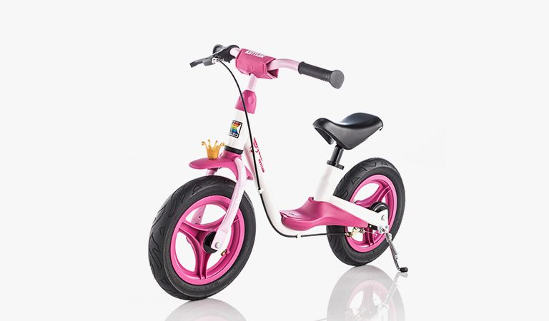 "Kettler's Spirit Air 12.5"" Princess balance bike on a grey background."