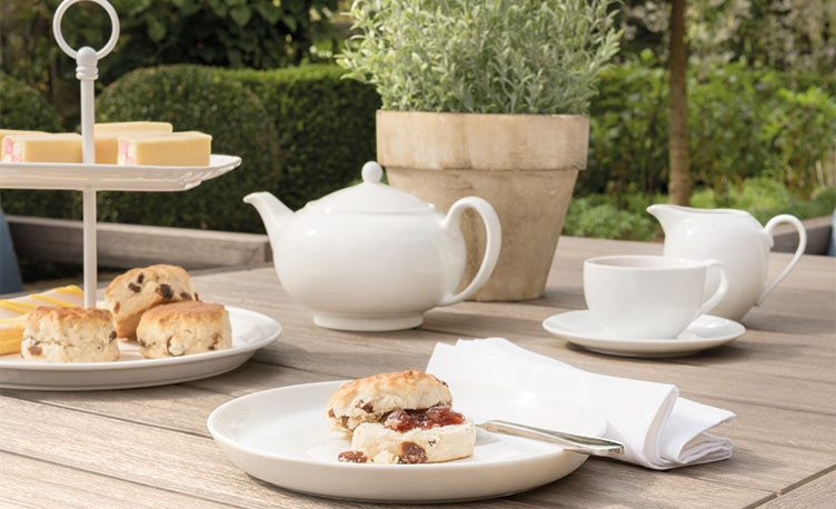 The Ezra Sofa Set with tea and cakes on top, similar to the one used in ITV's Love Your Garden.