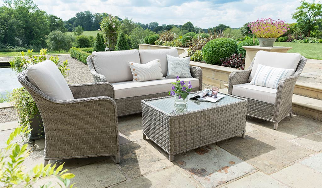 Kettler's Charlbury Lounge Set on a stoned patio in a garden.