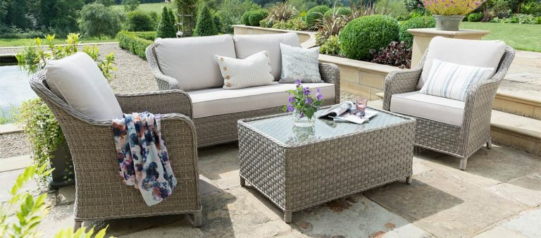 Kettler's Charlbury Lounge Seit with Coffee Table on a patio in the garden.