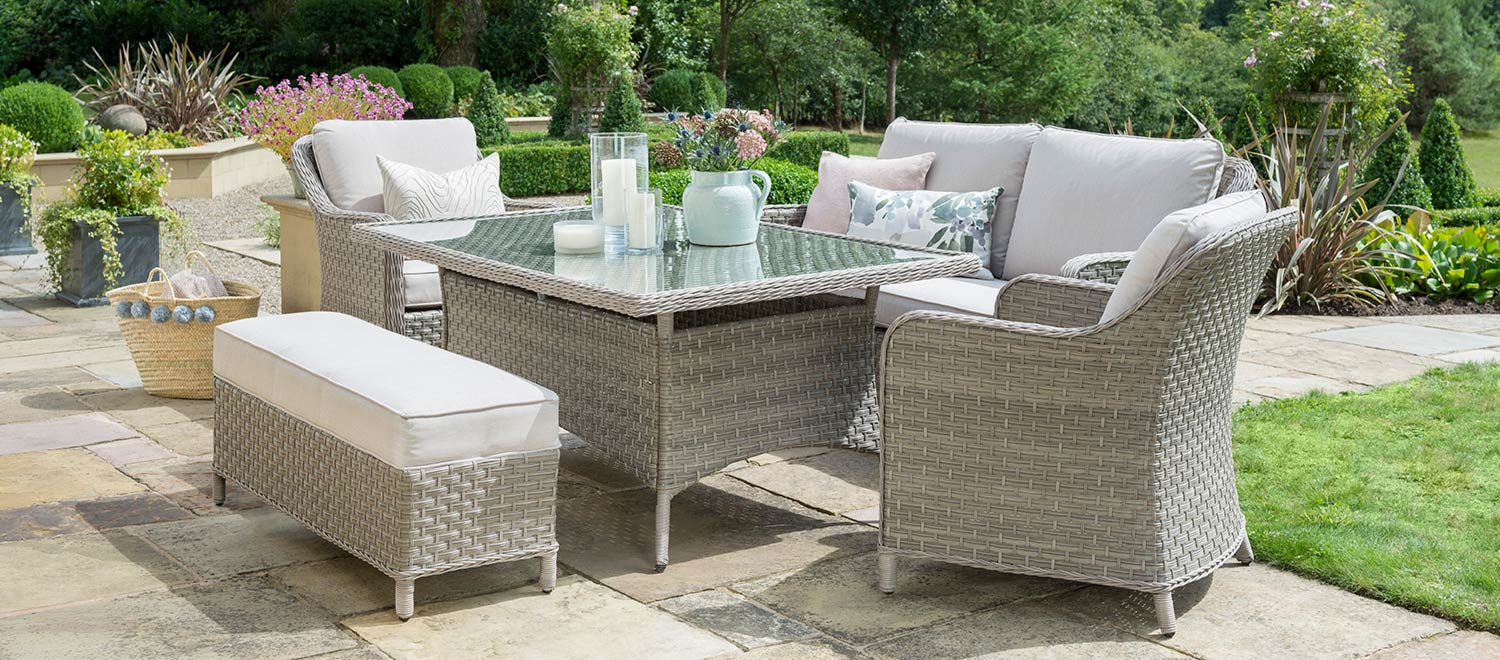 The Charlbury Dining Sofa Set in a garden.