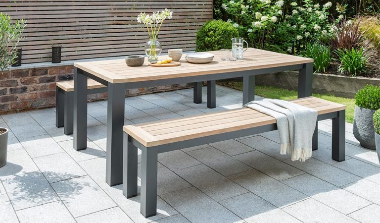 GArden fFurniture dining set containing the Elba Bench and Dining Chair on a patio.