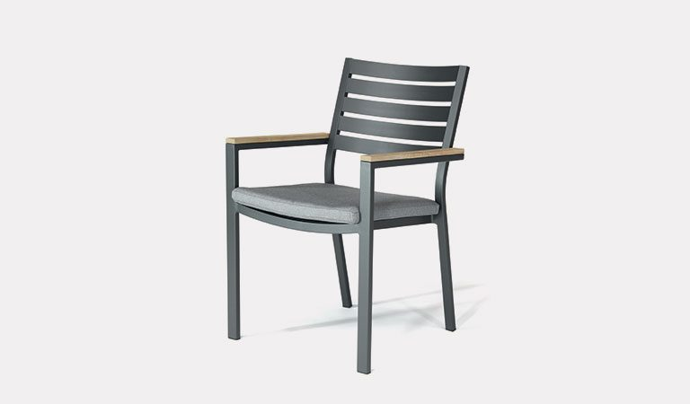 The Elba dining chair on a grey background.