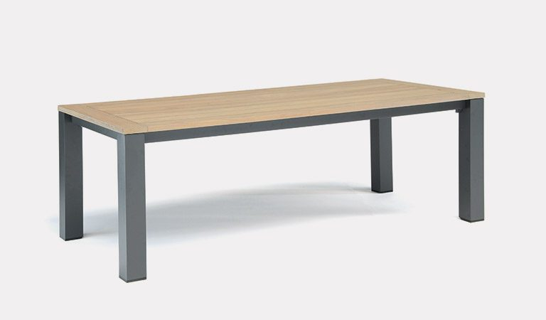 The Elba Dining Table on a grey background.