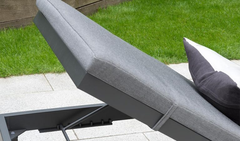 Detail of the Elba Garden Furniture Lounger on a slated patio.