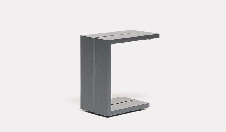 The Elba Garden furniture side table on a grey background.