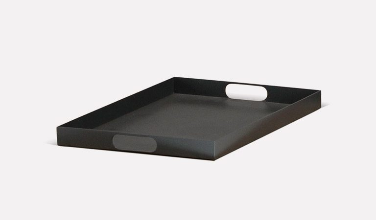 The Elba garden outdoor tray on a grey background.