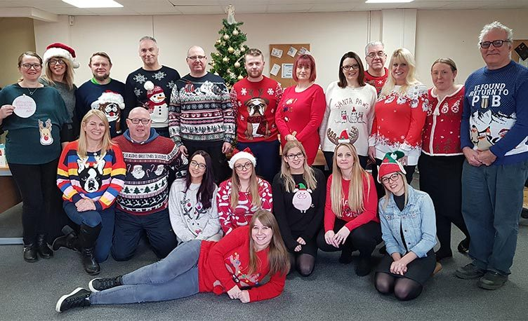 Members of the Kettler team wearing Christmas jumpers in the office,