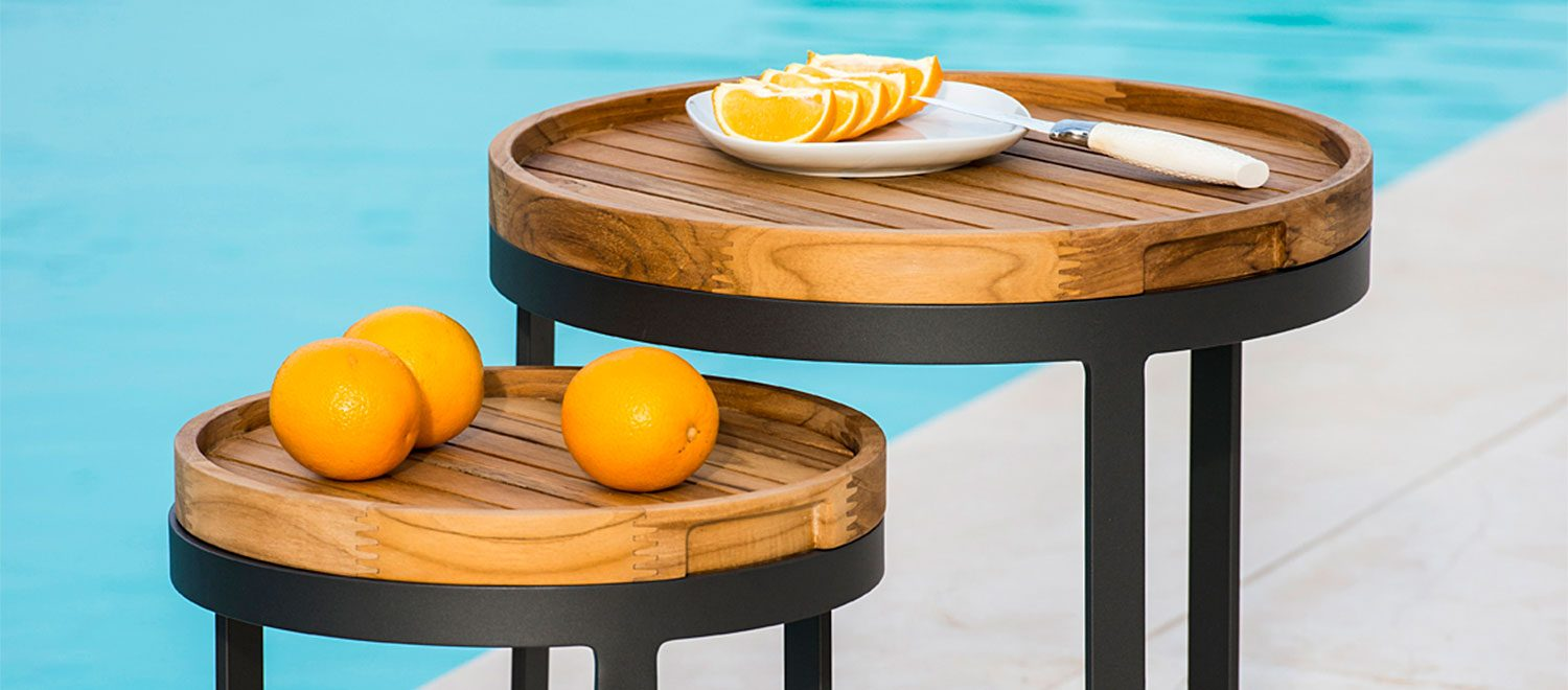 The Bertus Side Table Nest from the Jati & Kebon range on a patio.