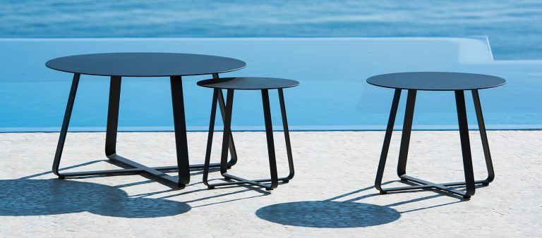 The Elko Side Tables from the Jati & Kebon range, on a patio.