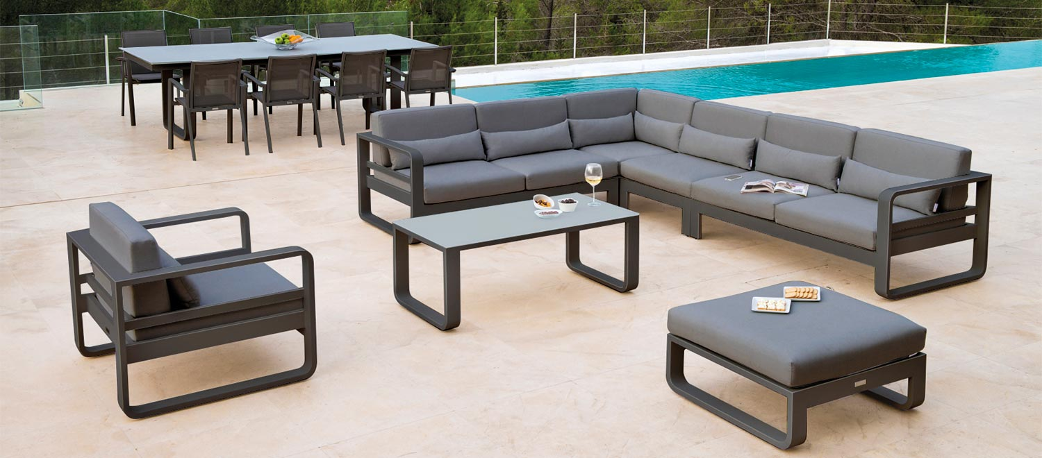 The Reno Corner modular garden furniture, from the Jati & Kebon garden range, on a patio.