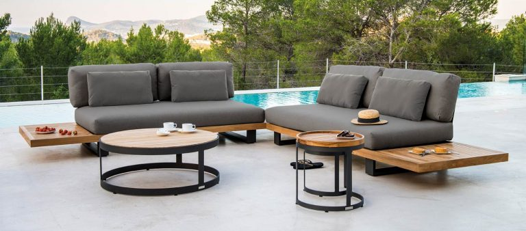 The Truro Lounge garden furniture with the Adagio Side Table and Bertus Side Table Nest, from the Jati & Kebon range, on a patio.