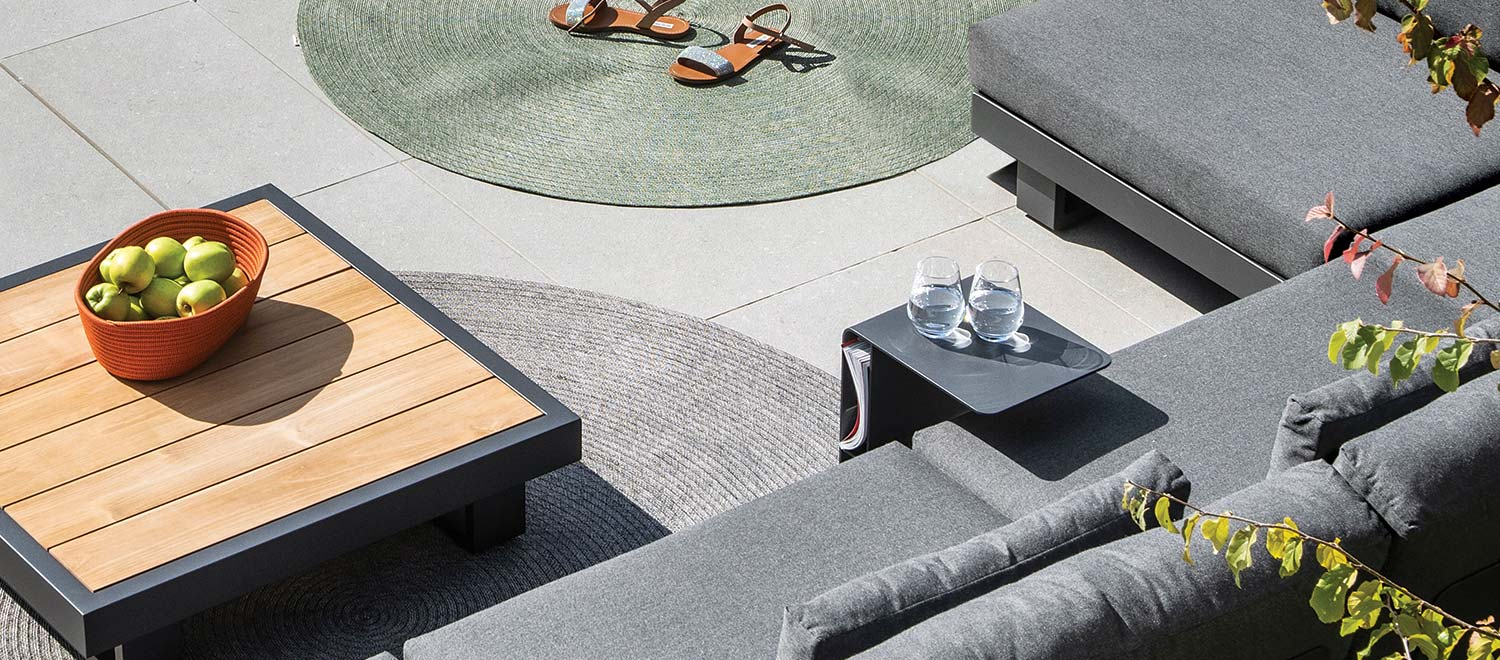 The Bari-Lite Side Table, from the Jati & Kebon range, on a patio.