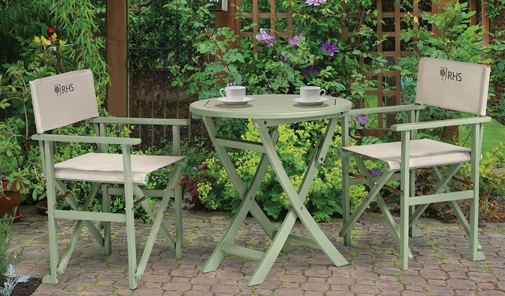 2 RHS By Kettler Rosemoor Director's Chairs with a Rosemoor Bistro Table on a patio.