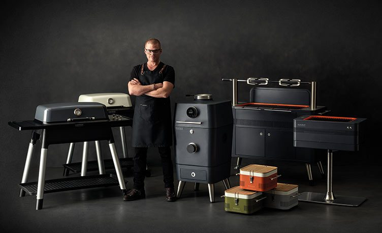 Heston Blumenthal stood in front of the Everdure by Heston Blumenthal BBQ range.