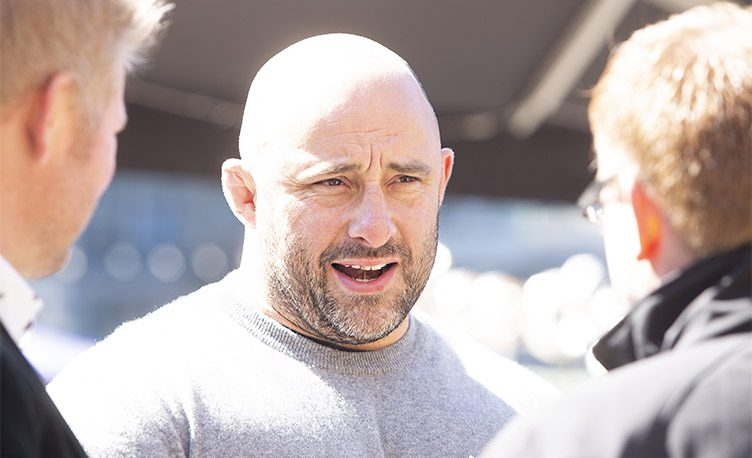 Ex-England rugby player David Flatman talking to guests at the Everdure by Heston Blumenthal 4K Launch party.
