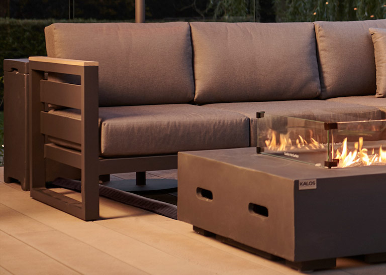An outdoor sofa and fire pit